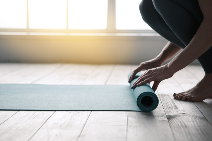 Woman and Yoga Mat