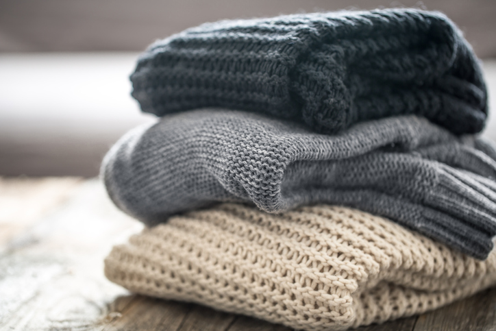 Cozy Sweaters in a Pile