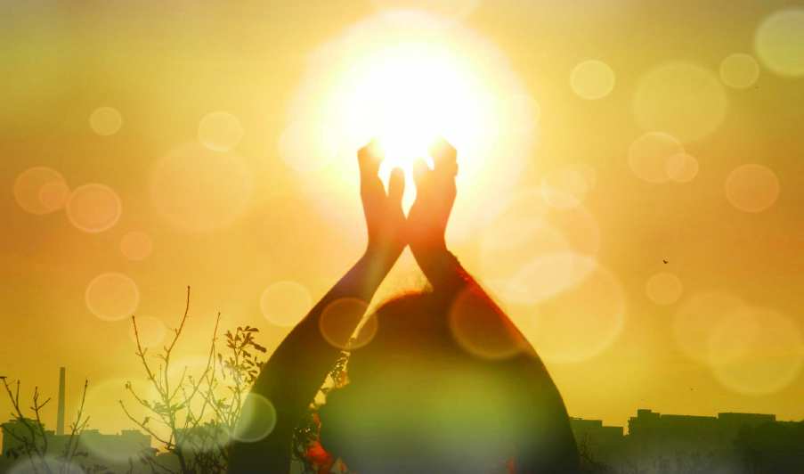 hands toward the sun
