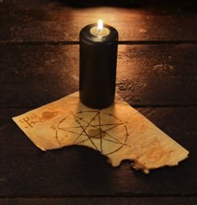 Black candle with pentagram