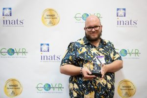 Publicist Jake-Ryan accepting a COVR Award